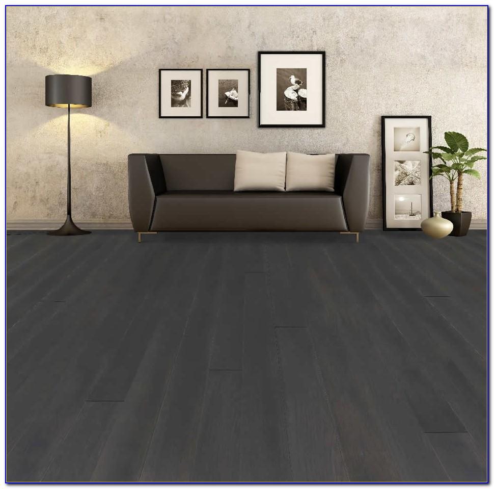 Dark Hardwood Floors With Grey Couch