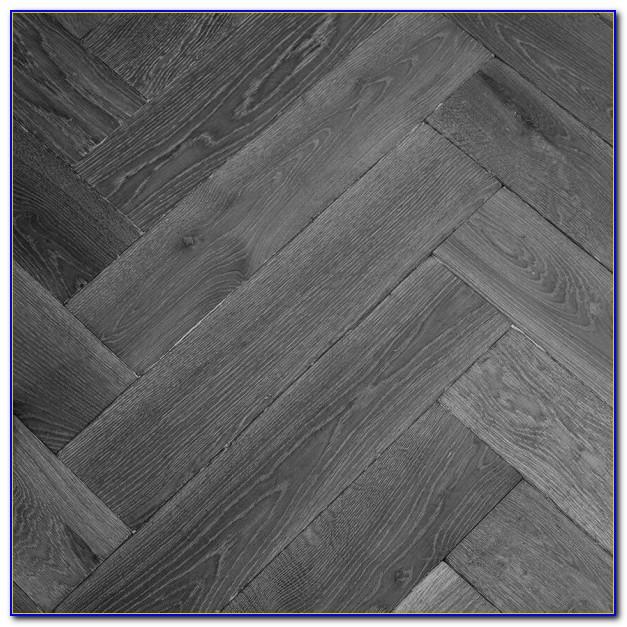 Grey Hardwood Floors With Dark Furniture