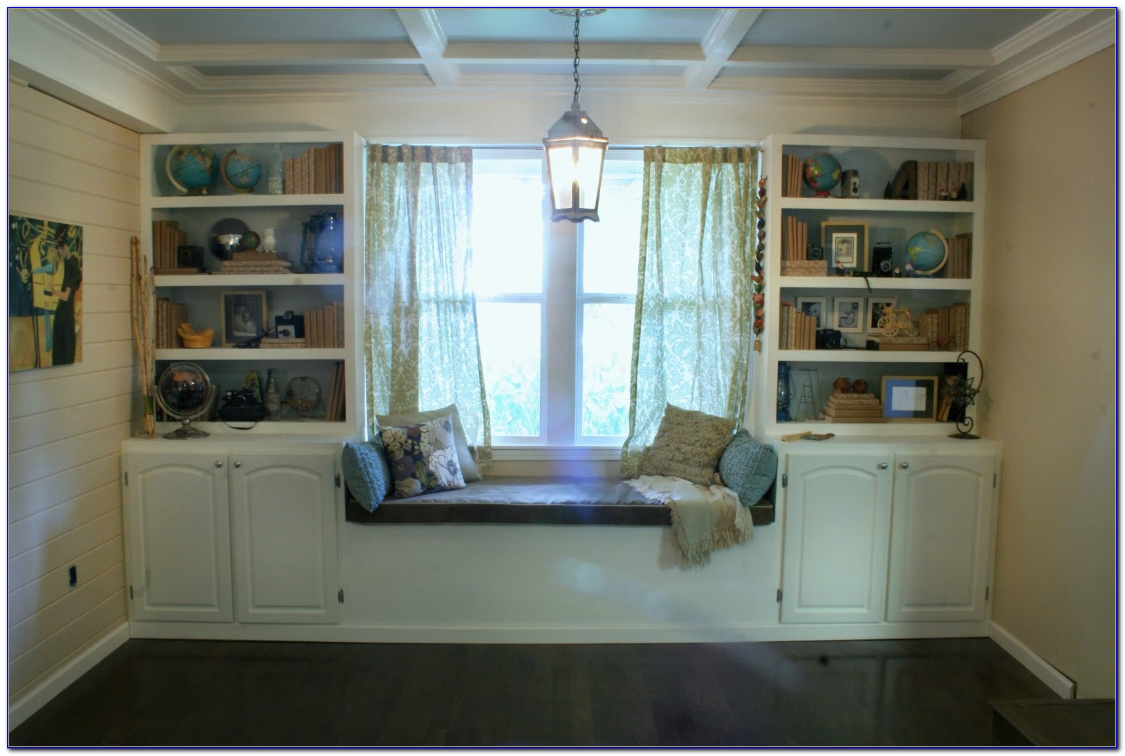 Window Seat Surrounded By Bookcases