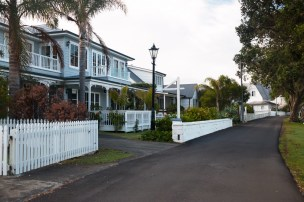 Old-fashioned street lights, white picket fences and plentiful gardens