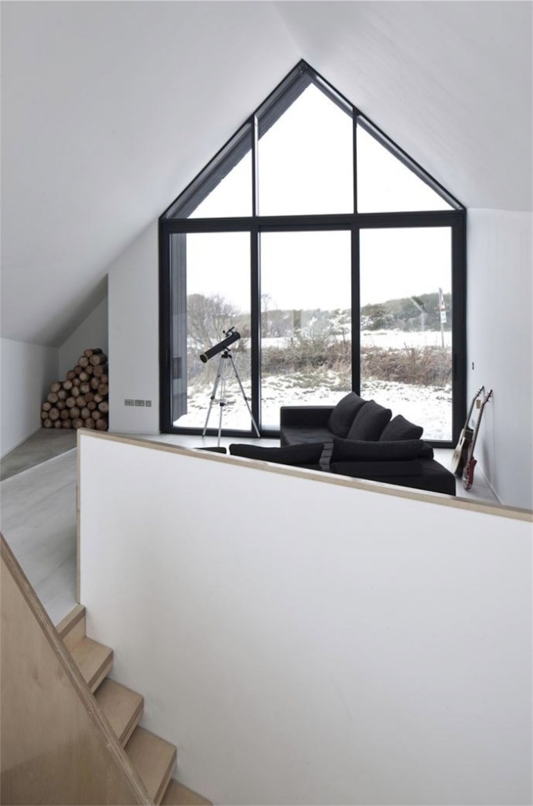 Minimalist-Living-Area-with-Huge-Pitched-Roof-Gable-Shaped-Window-677x1024-resized