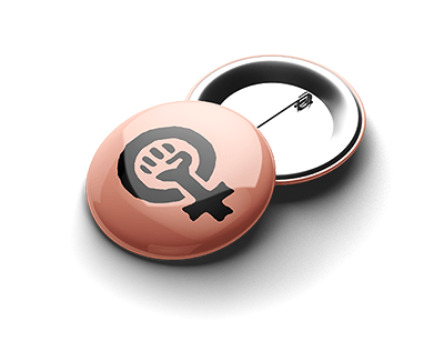 Two radfem pin buttons laying on a white surface.