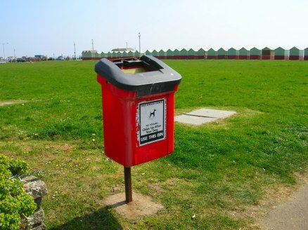 Pretty straightforward. If your unleashed dog poops on the lawn, you clean up the mess. (Image courtesy of Wikimedia)