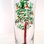 Glass vase with a ginger cat watching a bird in an apple tree, hand painted
