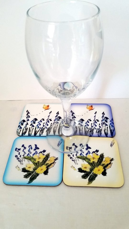 Coaster set with bluebells, primroses and butterfly