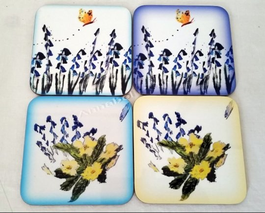Floral set of wood coasters with bluebells, primrose and butterflies