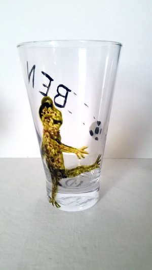 Personalised glass painting with a frog kicking football