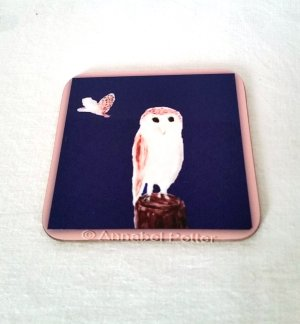 Barn Owl coaster with artwork of an owl perched and anotehr barn owl flying off in the distance