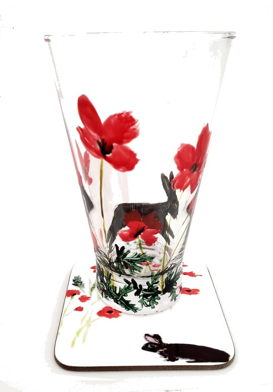 Poppy rabbit gift set with a hand painted glass and coaster with red poppies and a black rabbit.