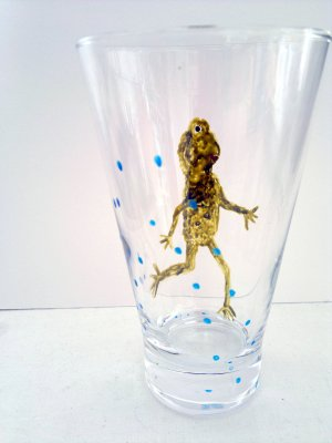 Glass painting with a frog running