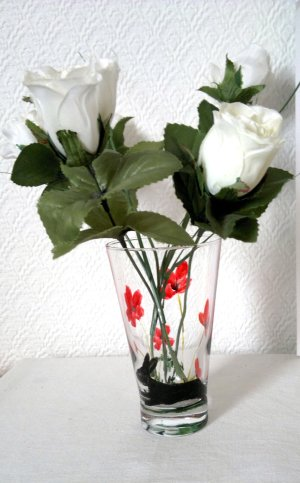 A poppy vase hand painted with a hare and red poppies