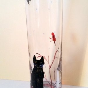 Black cat vase hand painted with a winter snow scene of a cat watching a robin with snow falling around them