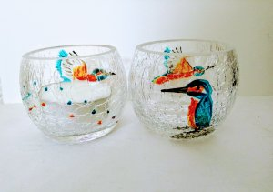 Two hand painted kingfisher candle holders with a crackle glaze