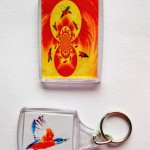 Flying kingfisher artwork on a keyring and fridge magnet