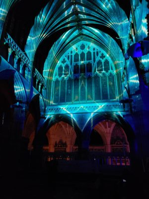 Exeter Cathedral interior lit up with a light show