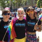 Alison, Jenni, and Cynthia participating in Vancouver's Pride Parade