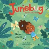 "Cover of Children's Book, ""Junebug: Not Life Too Small"", featuring a small child with brown skin and dark curly hair in a denim romper and yellow rain boots, laying on the grass looking up into the sky"