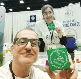 pulse kitchen co-founders Stephanos Liapis and Brigette holding up cheese