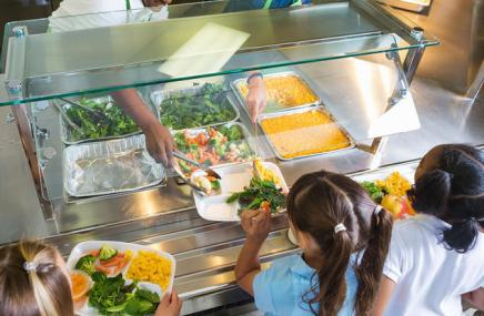 Cafeteria serving lunches to children