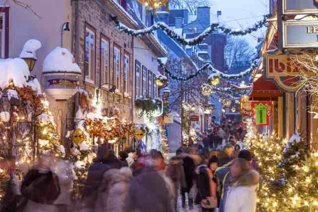 people shopping on Rue de Petit Champlain Quebec City during Christmas