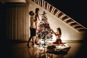 family decorating their christmas tree
