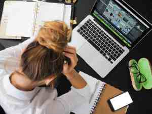 Woman get headache in front of laptop