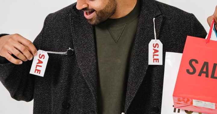 man in gray blazer with sale tags