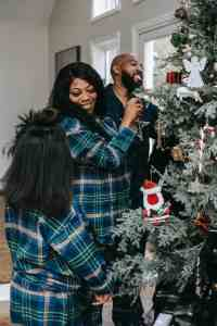 cheerful black family enjoying christmas preparation