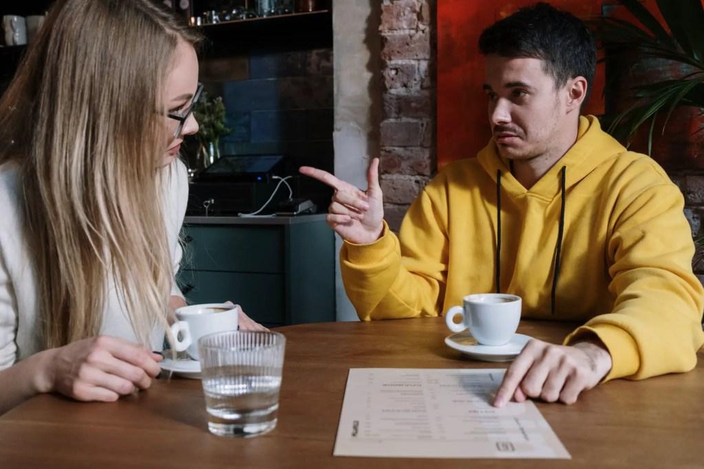 man in yellow sweater sitting beside woman in yellow sweater