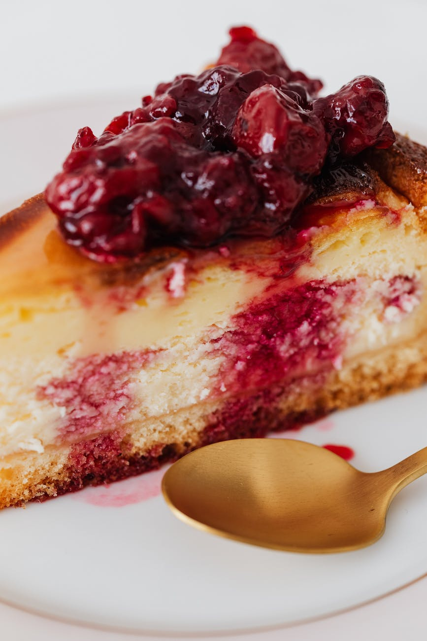 piece of cherry cheesecake on plate