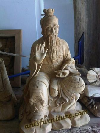 patung kayu biksu buddha