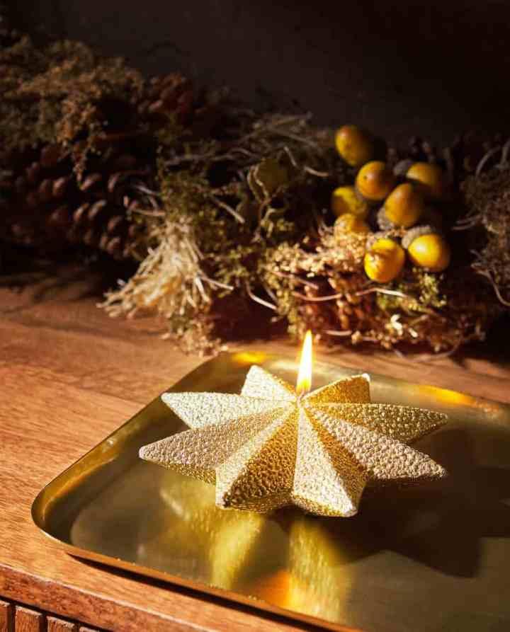 Kersthuis gouden kaars