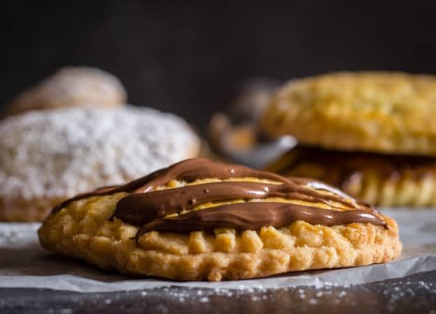 italian hazelnut cream hand pies drizzled with hazelnut cream