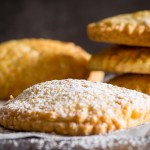 italian hazelnut cream hand pies sprinkled with powdered sugar