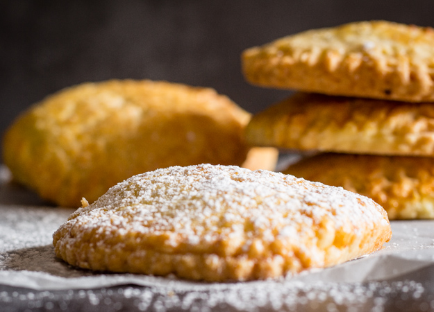 italian hazelnut cream hand pies sprinkled with powdered sugar
