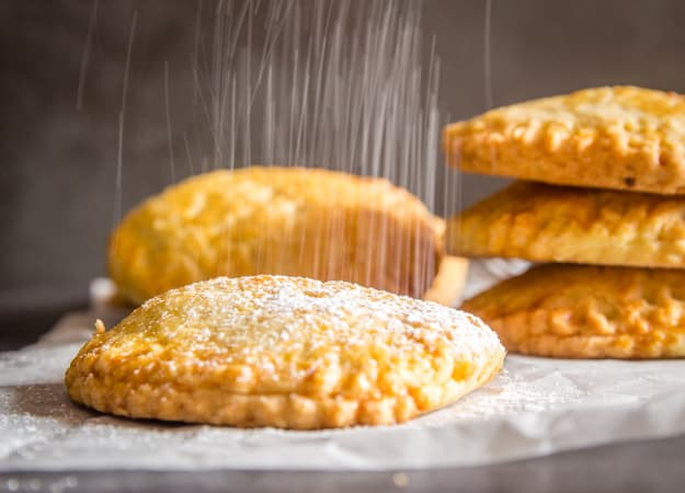 Italian hazelnut cream hand pies with a sprinkling of powdered sugar