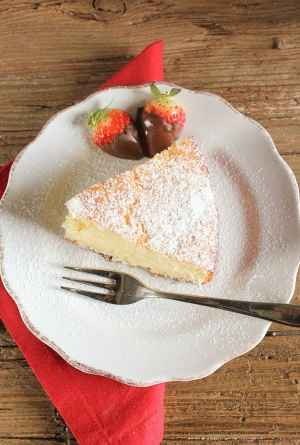 yogurt cake slice on a white plate with a fork