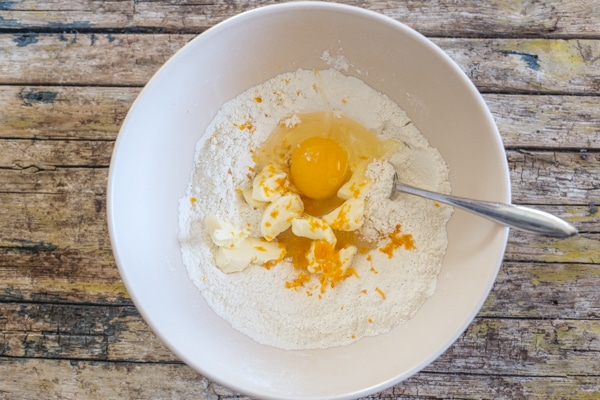 castagnole dough egg, butter and flour in a bowl