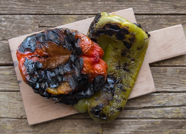 burnt peppers on a wooden board