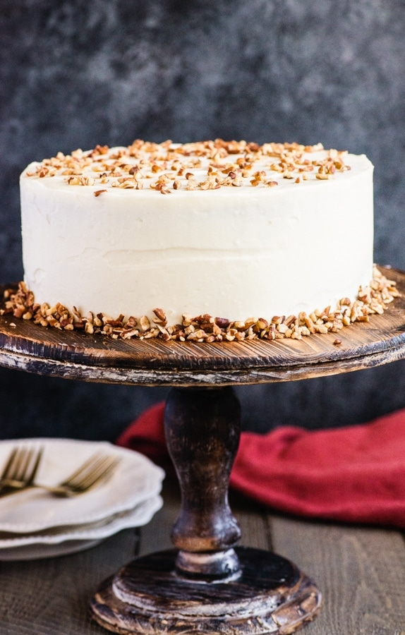 carrot cake on a wooden stand