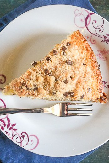 a piece of chocolate chip streusel cake on a white plate
