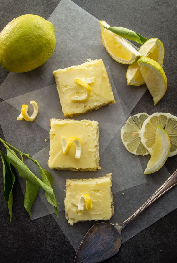 Lemon Cheesecake Squares, a delicious shortbread base & a creamy lemony filling. The perfect Cookie Bar or Dessert recipe.