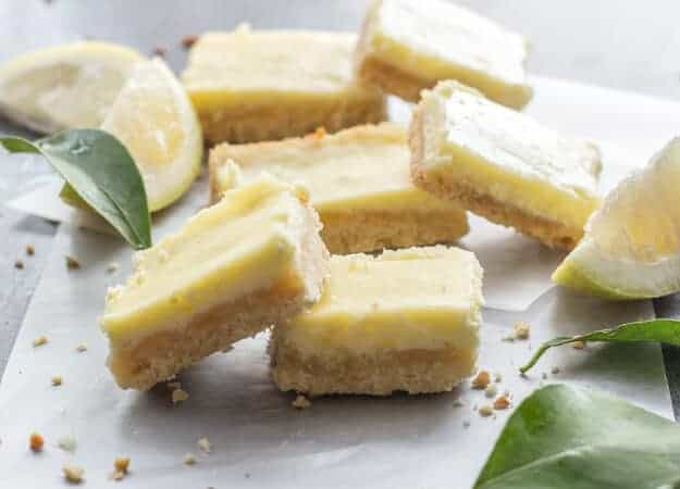 Lemon Cheesecake Squares, a delicious almond shortbread base & a creamy lemony filling. The perfect Cookie Bar or Dessert recipe.