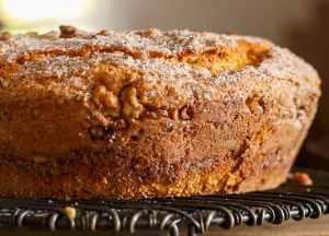 cinnamon walnut coffee cake on a wire cake stand