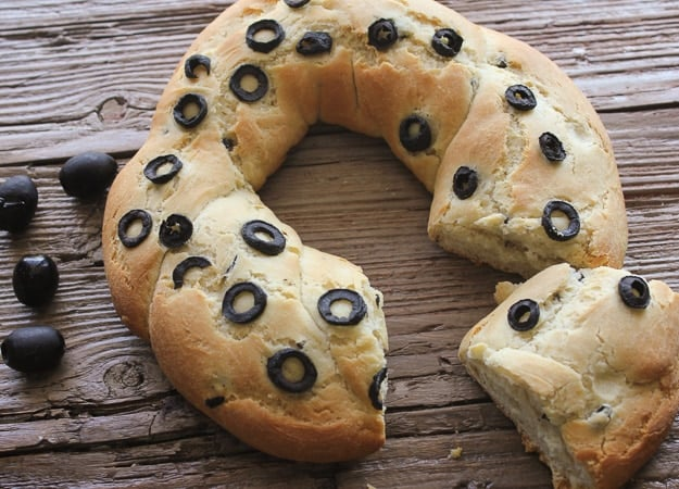 mediterranean black olive bread baked with a slice cut