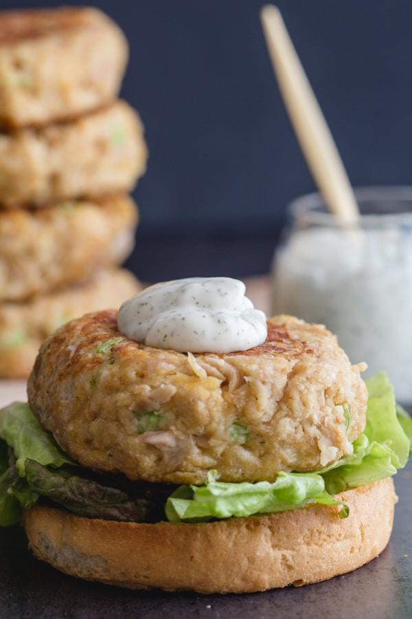 tuna burger with dill sauce on top