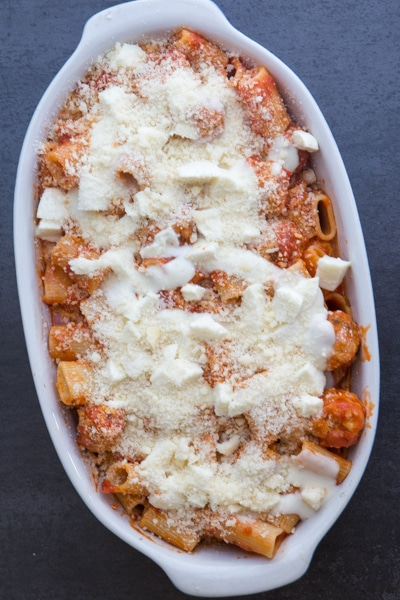 meatball casserole in a white baking dish to be baked