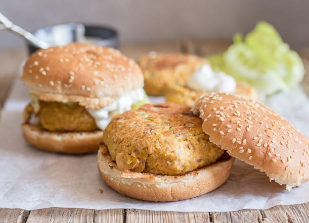 healthy salmon burgers on a white paper