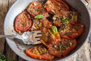 a pan fried tomato on a fork