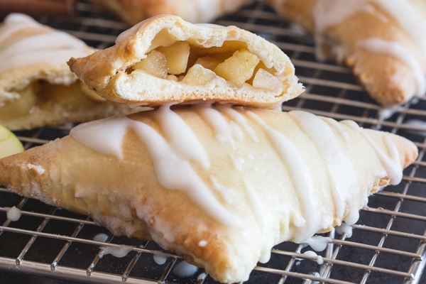 a cut in half apple turnover on top of another one